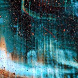 paint splatter on glass panel
