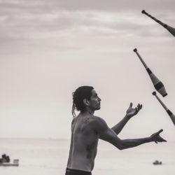 Juggler on a beach